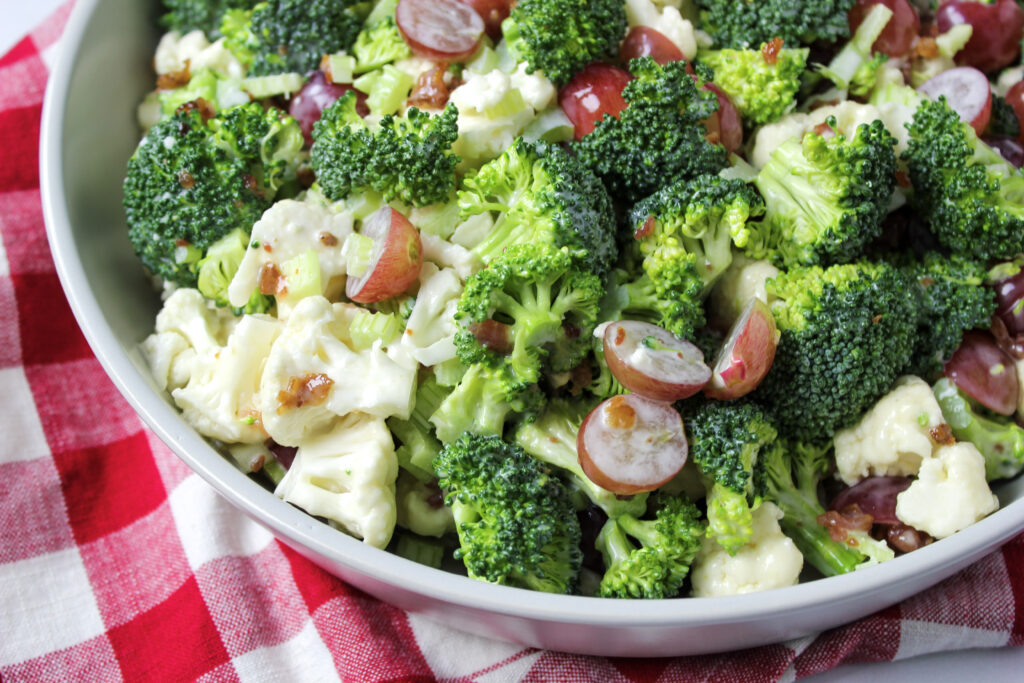 Broccli, cauliflower, red grapes and onion in a mayonnaise light dressing