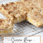 peaches and cream bars on cooling rack with one piece removed