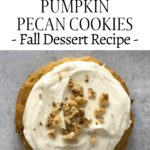 one cooke with icing and pecans