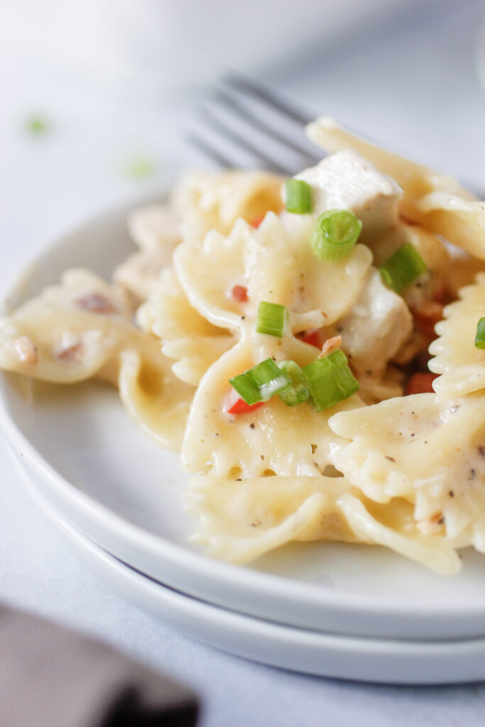 close up of pasta on two plates with brown napkin